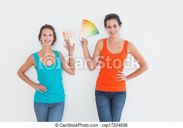 Female friends choosing color for painting a room - csp17224636