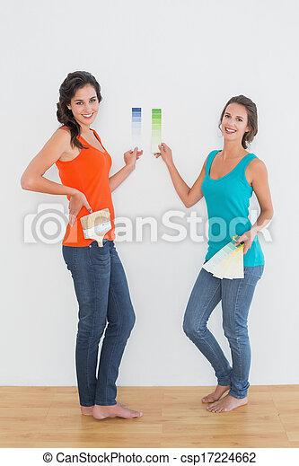Female friends choosing color in a  - csp17224662