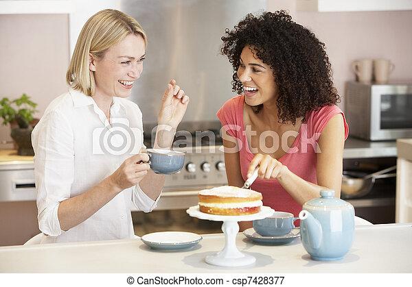 Female Friends Enjoying Tea And Cake At Home - csp7428377