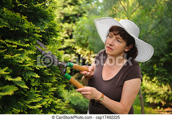 Female gardener with clippers - csp17492225
