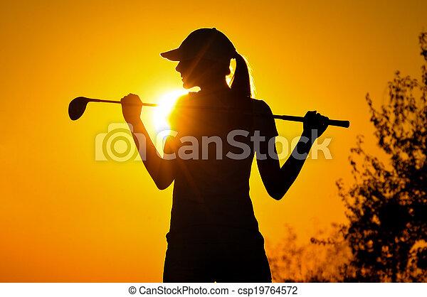 Female golfer at sunrise - csp19764572