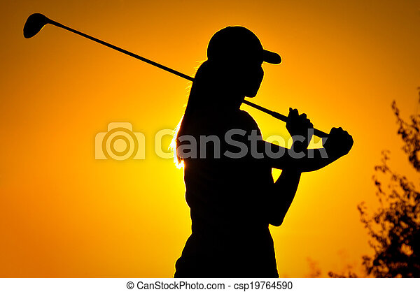 Female golfer at sunrise - csp19764590