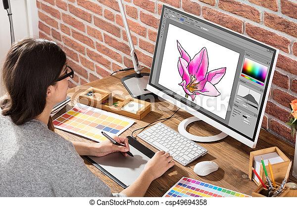 Female Graphic Designer Using Graphic Tablet - csp49694358