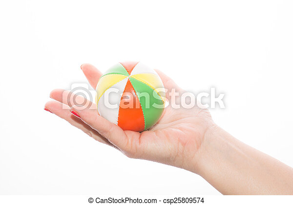 female hand holding colored juggling balls on a white background - csp25809574
