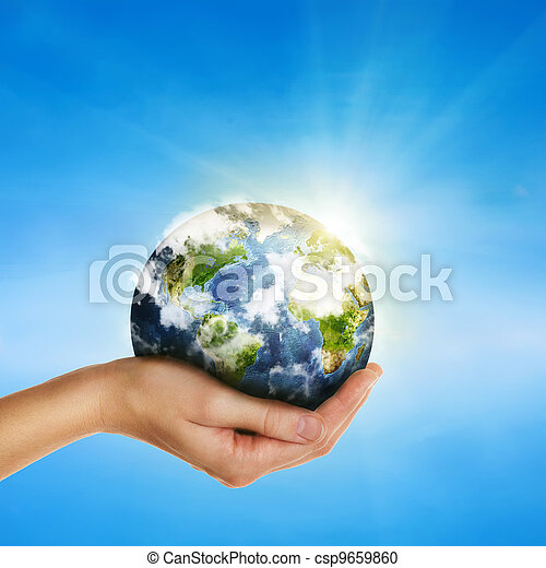 female hand holding globe over blue sky - environment protection and travel concept -Elements of this image furnished by NASA - csp9659860