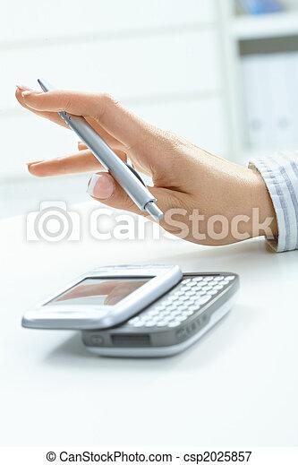 Female hand holding pen - csp2025857