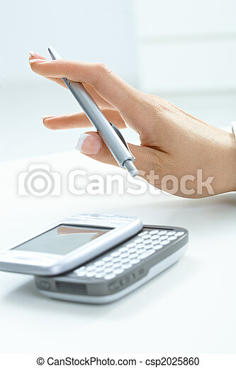 Female hand holding pen - csp2025860