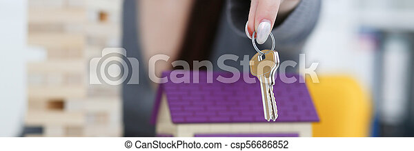 Female hand holds the key to the lock in - csp56686852