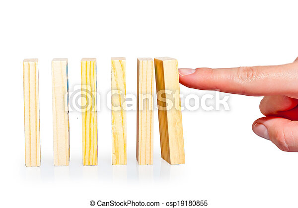 female hand pushing a row of dominoes lined up - csp19180855