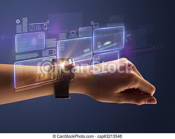 Female hand with smartwatch and dark background - csp63213548