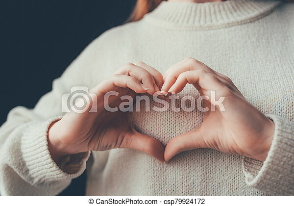 Female hands in the form of heart. - csp79924172