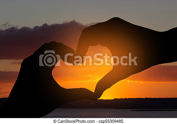 Female hands in the form of heart - csp55309485