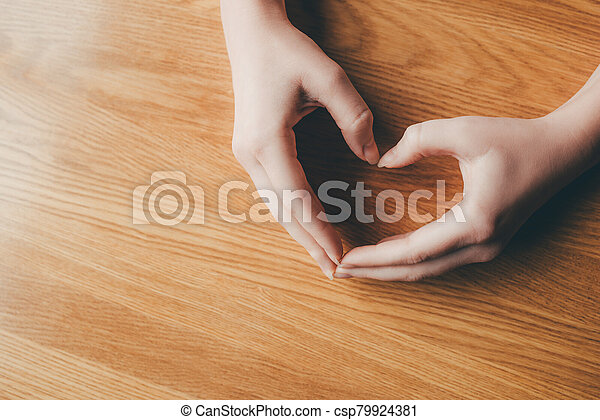 Female hands in the form of heart. - csp79924381