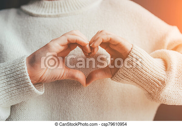 Female hands in the form of heart. - csp79610954