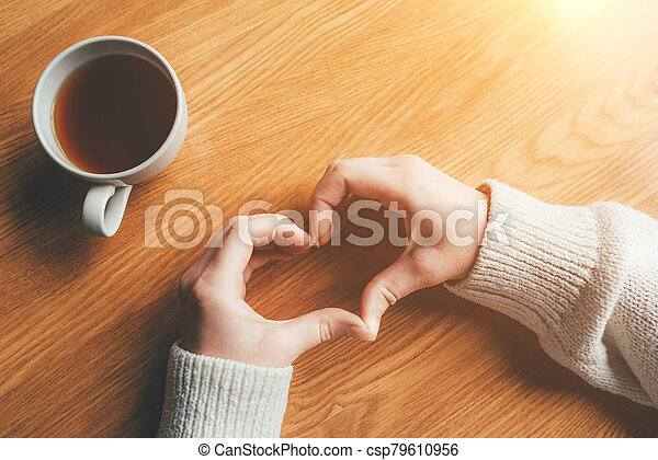 Female hands in the form of heart. - csp79610956