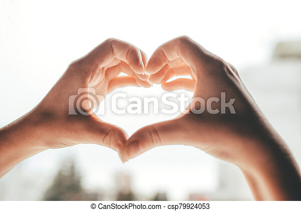 Female hands in the form of heart. - csp79924053