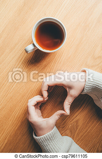 Female hands in the form of heart. - csp79611105