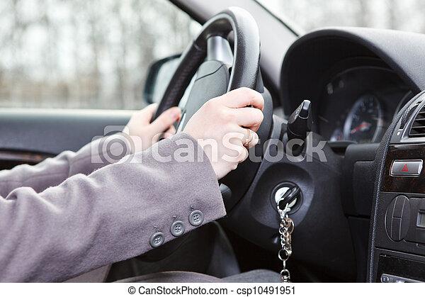 Female hands on steering wheel in land vehicle - csp10491951