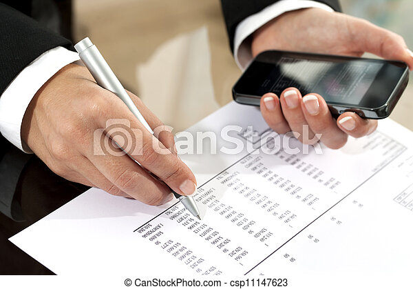 Female hands reviewing accounting document. - csp11147623