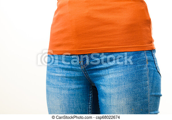 Female hips wearing blue jeans - csp68022674