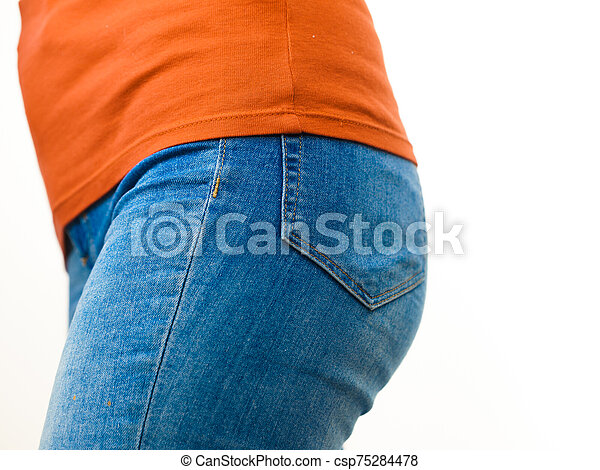 Female hips wearing blue jeans - csp75284478