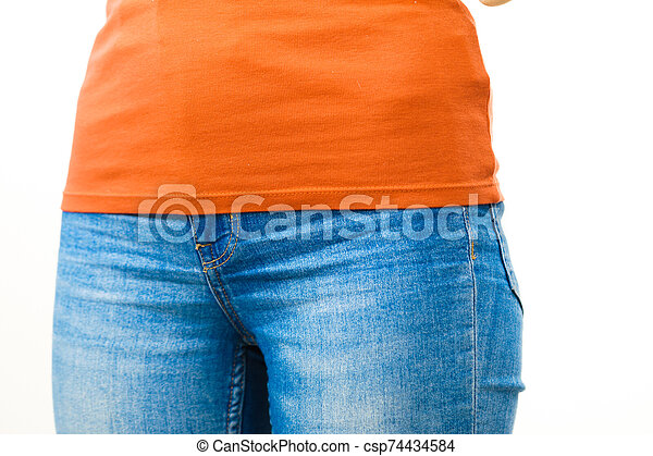 Female hips wearing blue jeans - csp74434584