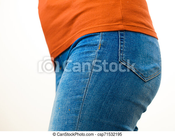 Female hips wearing blue jeans - csp71532195