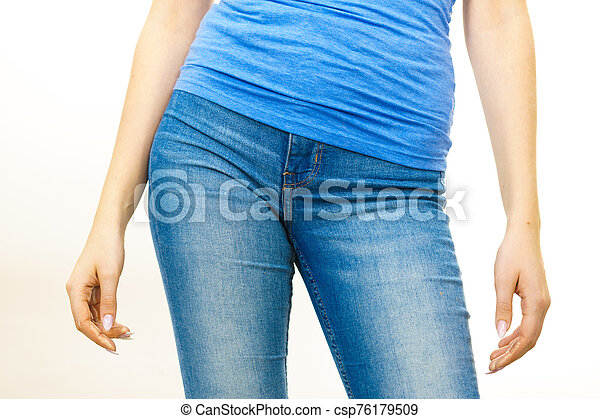 Female hips wearing blue jeans - csp76179509