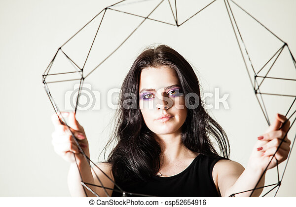 Female holding model of geometric solid - csp52654916