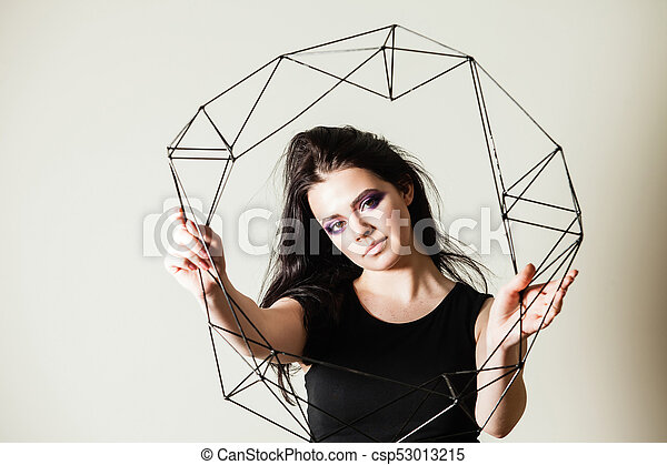 Female holding model of geometric solid - csp53013215