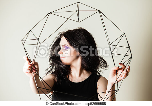 Female holding model of geometric solid - csp52655588