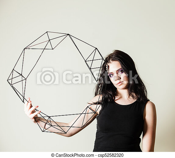 Female holding model of geometric solid - csp52582320