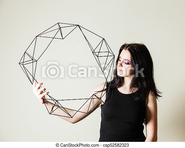 Female holding model of geometric solid - csp52582323