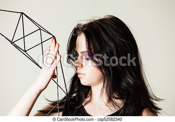 Female holding model of geometric solid - csp52582340
