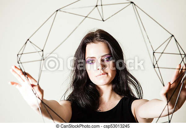 Female holding model of geometric solid - csp53013245