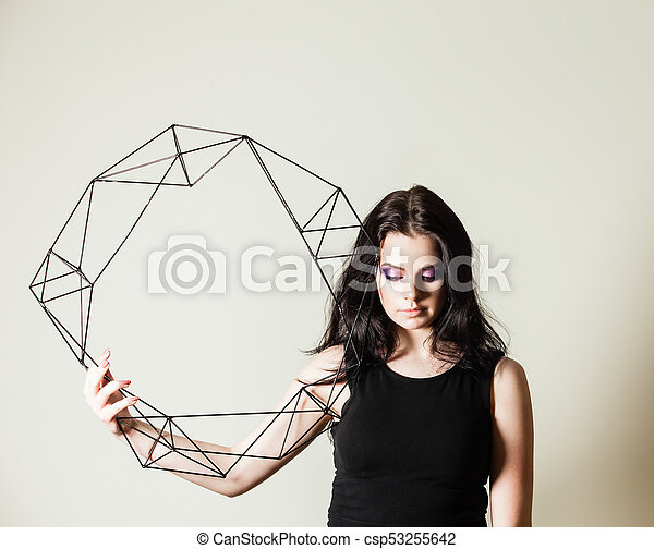 Female holding model of geometric solid - csp53255642