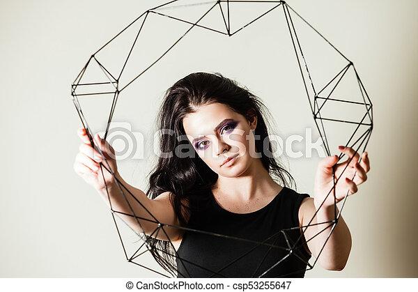 Female holding model of geometric solid - csp53255647