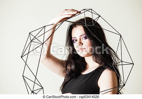 Female holding model of geometric solid - csp53414526