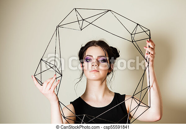 Female holding model of geometric solid - csp55591841