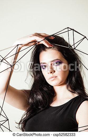 Female holding model of geometric solid - csp52582333