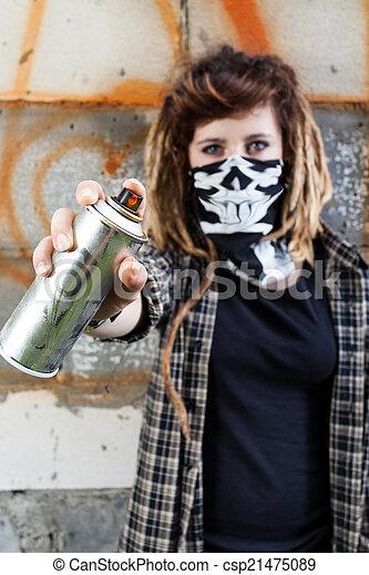 Female hooligan holding graffiti spray - csp21475089