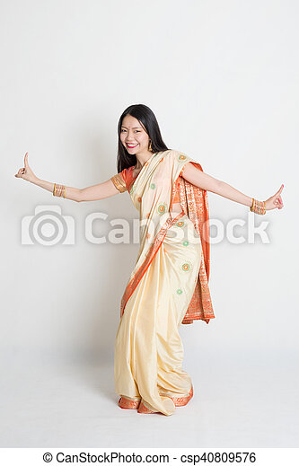 2bf83bee3d Female in indian sari dress dancing. Portrait of young mixed race ...