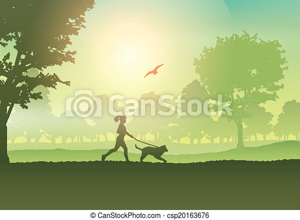 Female jogging with dog in countryside - csp20163676