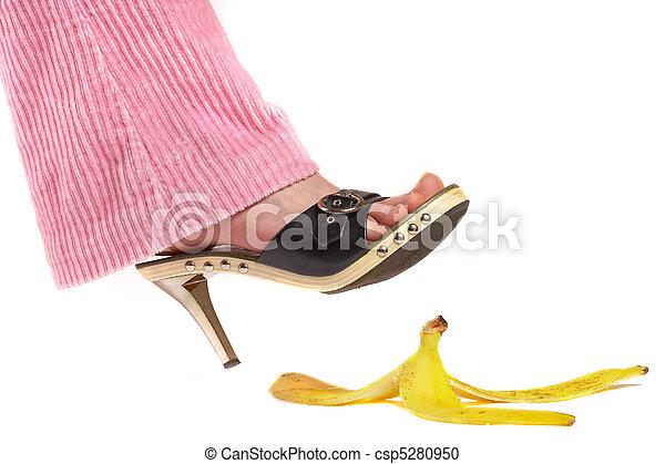 Female leg(foot) and peel of a banana. Life insurance.  - csp5280950