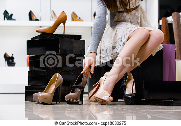 Female legs and variety of shoes - csp18030275