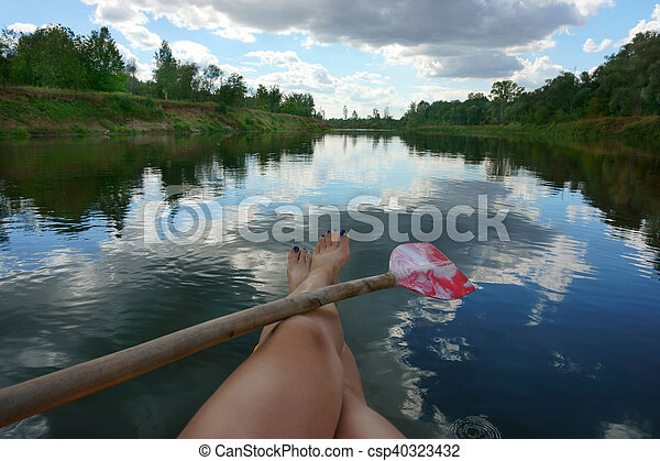 female legs in the river and paddle - csp40323432