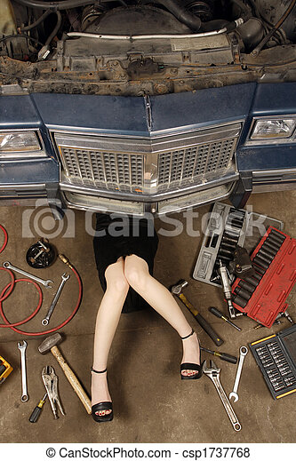 Female mechanic fixing stuff - csp1737768