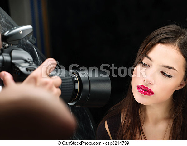 female model on photo shoting in studio - csp8214739
