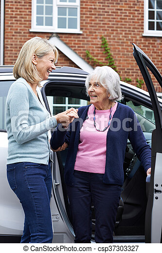 Female Neighbor Giving Senior Woman A Lift In Car - csp37303327