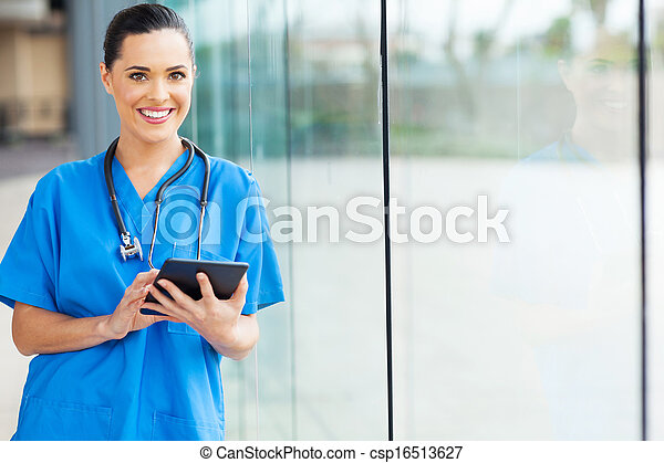 female nurse using tablet computer - csp16513627